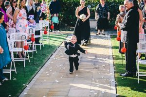 The cute little ring bearer sprinting down the wedding aisle with the rings!